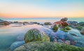 Sea, ocean, shore, coast, beach, stones, shape, long exposure, blurred, wave, water, calm, smooth, spacious, evening, sunset, morn Royalty Free Stock Photo