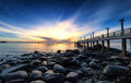Sea pier sunrise photography dramatic nature Stock Photo