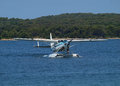 Sea plane landing on water surface Stock Photography