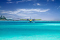 Sea plane taking off in ocean Royalty Free Stock Photography