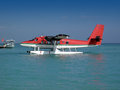 Sea plane about to drop off passengers onto an island Stock Image