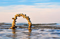 Sea portal arch of pebbles on the surface of the Royalty Free Stock Photo