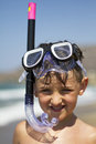 At sea portrait of girl on a beach wearing snorkeling equipment Stock Image
