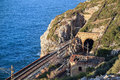 The sea and the railway tunnel near the town of El Garraf. Spain. Royalty Free Stock Photo