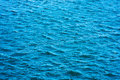 Sea ripples. Bright blue nature background. Royalty Free Stock Photo