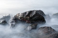 Sea rocks long exposure of in the morning Royalty Free Stock Photos
