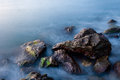 Sea rocks long exposure of in the morning Stock Images