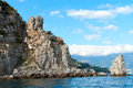 Sea and rocks medieval knight s castle on a high cliff by the Stock Photography
