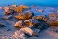 Sea rocks in mist at dusk