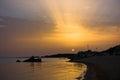 Sea rocks on a sandy beach at sunset west coast of peninsula sithonia chalkidiki greece Royalty Free Stock Photos