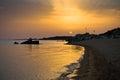 Sea rocks on a sandy beach at sunset west coast of peninsula sithonia chalkidiki greece Stock Photos