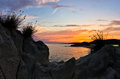 Sea rocks at sunset west coast of sithonia chalkidiki with mediterranean dry grass peninsula greece Stock Images