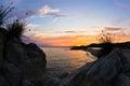 Sea rocks at sunset west coast of sithonia chalkidiki with mediterranean dry grass peninsula greece Stock Photo