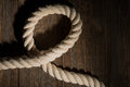 Sea rope on a wooden background. Royalty Free Stock Photo