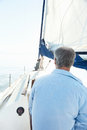 Sea sailing man view from behind of men on hobby boat at Stock Images