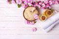 Sea salt in bowl, bottles with aroma oils, towels and pink flowe Royalty Free Stock Photo