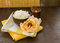 Sea salt in bowl with candle and rose on wooden background flower dark selective focus Royalty Free Stock Image