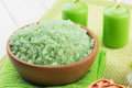Sea salt in bowl  on green towel Royalty Free Stock Photo