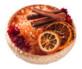 Sea salt with dried oranges and cinnamon sticks isolated on white Royalty Free Stock Photography