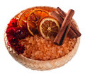 Sea salt with dried oranges and cinnamon sticks isolated on white Royalty Free Stock Photos