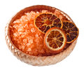 Sea salt with dried oranges isolated on white Royalty Free Stock Photos