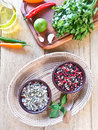 Sea salt with herbs and spices in a wood bowl Stock Image