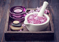 Sea salt in mortar, Zen massage stones and lilac flowers. Spa. Royalty Free Stock Photo
