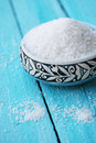 Sea salt in a turquoise bowl with pattern Royalty Free Stock Photo