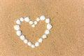 Sea shell heart on the sand beach Royalty Free Stock Photo