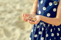 Sea shells child hands holding Stock Images