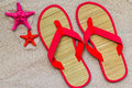 Sea shells flip flops beach sand Royalty Free Stock Photo