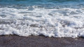 Sea shore with foamy blue water Royalty Free Stock Photo