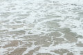 Sea shore foamy water Royalty Free Stock Photo