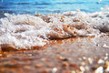 Sea shore in splashing motion Stock Photos