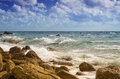 Sea shore waves lapping on the rocks Stock Image