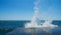 Sea splash background sunlit in summer Stock Photos
