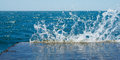 Sea splash background sunlit in summer Stock Images