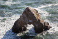 Sea stack eroding off of northern california the rugged coast is shaped by endless waves and wind coming from the pacific ocean Stock Photo