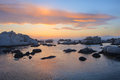 Sea stones after sunset corsica with orange clouds france Royalty Free Stock Photos