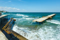 Sea storm and ruined pier bulgaria with gulls on him black near varna Stock Photography