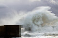 Sea storm waves crashing against pier mouth douro river stormy day Stock Photos