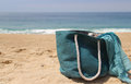 Sea and sun beach blue straw bag with the shawl Stock Photos