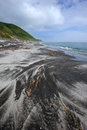 Sea surf on the beach of volcanic sand. Iturup. Stock Photos