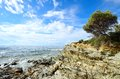 Sea surf on the coast of sardinia italy Royalty Free Stock Image