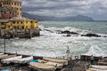 Sea in tempest on rocks of italian village with splashes Royalty Free Stock Photography