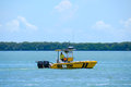 Sea tow boat towing service captain on call cruising in his along the shoreline Stock Images
