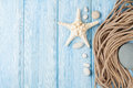 Sea vacation background with star fish and marine rope Royalty Free Stock Photo