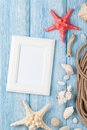 Sea vacation with blank photo frame, star fish and marine rope Royalty Free Stock Photo