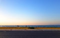 Sea view from road before sunset with an empty bench Royalty Free Stock Photo