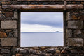 Sea view from a stone window of an old ruin near the ocean Royalty Free Stock Photo